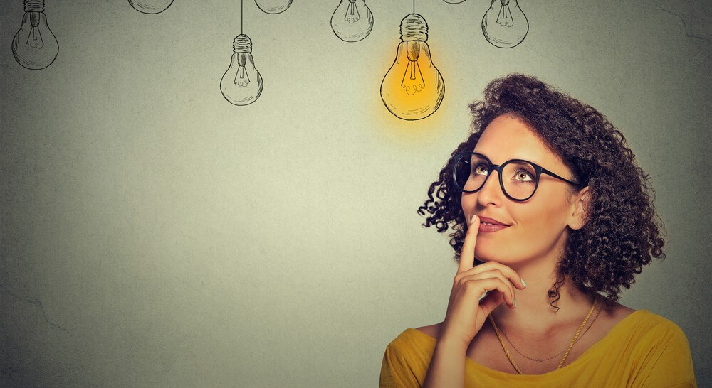 thinking-woman-with-lightbulbs-in-background