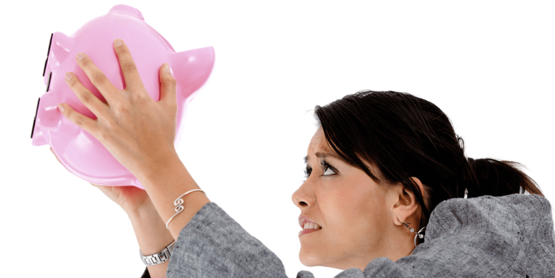 a woman looking for money in her piggy bank